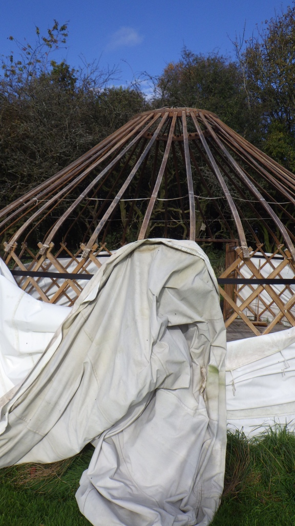 A Ghost in front of a topless Yurt